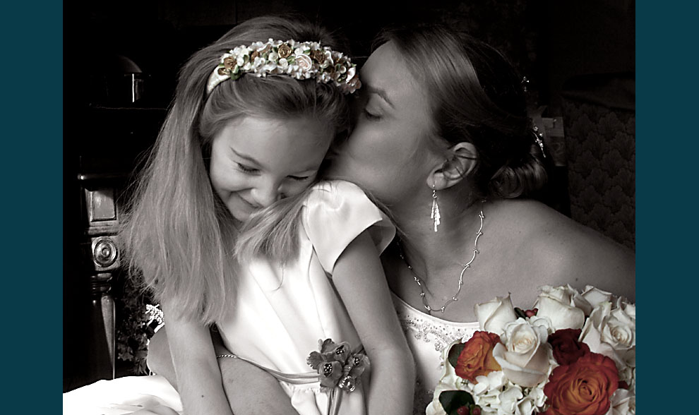 photo of bride and flower girl