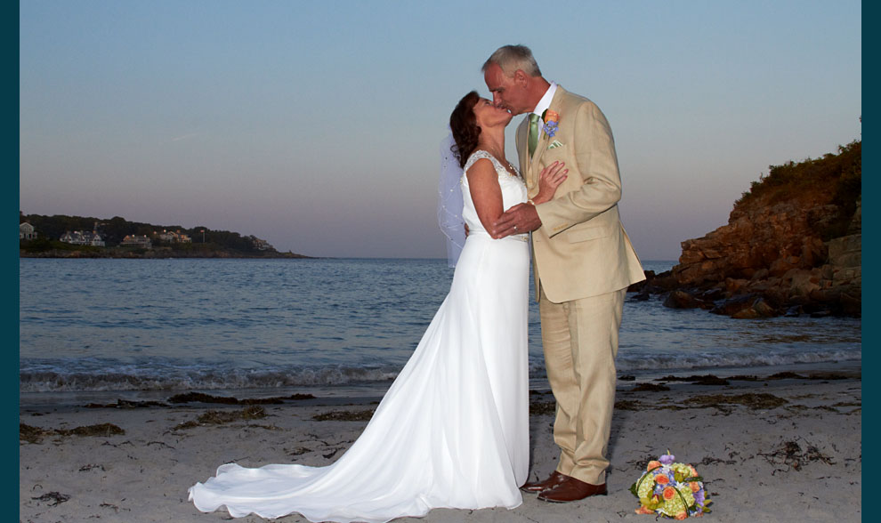 photo of newlywed couple on NH beach